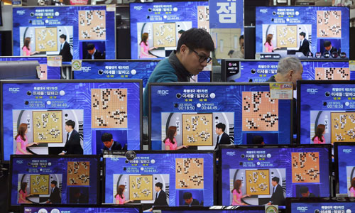 Televisions broadcasting the chess-playing machine against a South Korean professional player